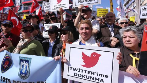 """Protesters hold placards reading """"Do not touch my Twitter"""" during a protest against the Turkish government's Twitter ban."""