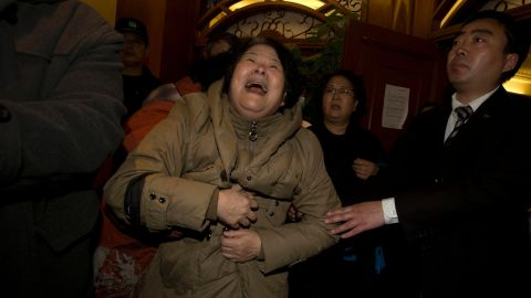 A relative of one of the Chinese passengers aboard the Malaysia Airlines jet, MH370 grieves after being told of the latest news in Beijing, China, Monday, March 24, 2014. It was the grim news that families of the missing Malaysian Airlines flight had dreaded for weeks, and on Monday they heard it from Malaysia's prime minister: new analysis of satellite data indicates the missing plane crashed into a remote corner of the Indian Ocean. (AP Photo/Ng Han Guan)