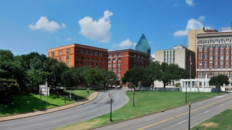 """<strong>Dealey Plaza (Dallas, Texas):</strong> Lee Harvey Oswald shot John F. Kennedy from the sixth floor of the former Texas School Book Depository -- now the Sixth Floor Museum dedicated to the assassination and legacy of JFK. A white """"X"""" marks the spot where the bullets entered the president in November 1963."""