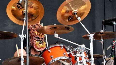 Drummer Brad Roberts performs as the dog-headed Jizmak Da Gusha.