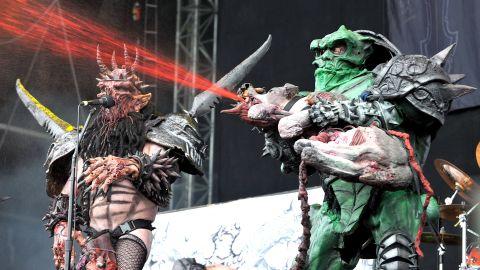 Gwar servant Bonesnapper the Cave Troll sprays fake blood on the audience.