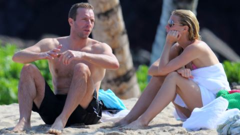 Chris Martin and ex-wife Gwyneth Paltrow, seen on a beach in Hawaii in 2014, have remained good friends.