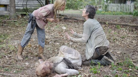 """Among the most shocking deaths in the fourth season was that of young Lizzie (Brighton Sharbino, left), who died at the hands of Carol (Melissa McBride, right) after killing her younger sister, Mika. Lizzie's sense of right and wrong and life and death had been warped by the zombie apocalypse. Just as she did earlier in the season, Carol had to make the decision that someone was too dangerous to live. Carol urged Lizzie to follow her therapy of """"look at the flowers"""" before she shot her in the back of the head."""