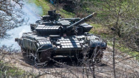 A Russian tank rolls outside a former Ukrainian military base in Perevalnoye, near the Crimean capital Simferopol, on March 27, 2014.