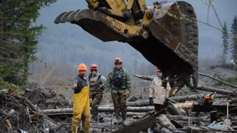 Heavy machinery is used to move debris as members of the Air National Guard search for victims on March 29.