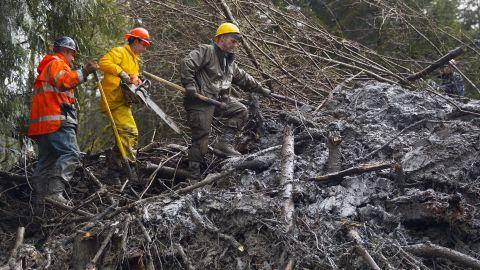 Rescue workers dig through mud and debris near Darrington, Washington, on Saturday, March 29.
