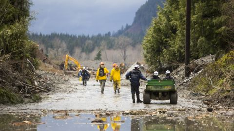 Rescue personnel work the site of the landslide on Saturday.