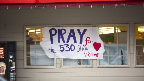 A sign in front of a Darrington supermarket expresses support for those affected by the landslide. There are dozens of signs like this in Darrington.