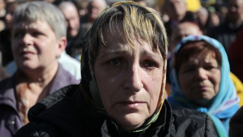 A woman cries during a gathering to honor those who were killed during protests in Kiev's Independence Square on Sunday, March 30.