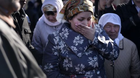 The wife of Reshat Ametov wipes her tears during his funeral in Simferopol on March 18, 2014.