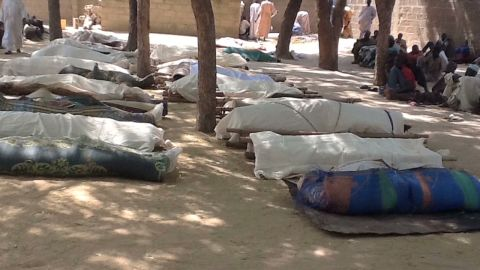 Dead bodies are laid out for burial, in the village of Konduga, in northeastern Nigeria, on February 12, 2014 after a gruesome attack by Boko Haram Islamists killed 39 people.