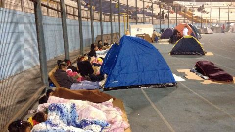 Locals take refuge at the city stadium following a tsunami alert after a powerful earthquake hit off Chile's Pacific coast, on April 2, 2014 in Iquique