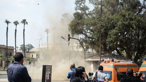 Egyptian look on as a bomb struck a police post near Cairo University in the centre of Egypt's capital on April 2, 2014, which was followed by two further blasts.