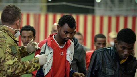 [File photo] Migrants are rescued off the island of Lampedusa on October 25, 2013.
