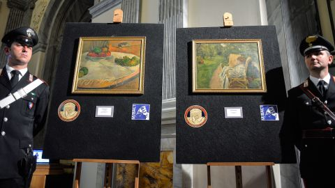 Italy's Culture Ministry unveils two paintings by the French artists Paul Gauguin and Pierre Bonnard on April 2, 2014. The paintings were stolen from a family house in London in 1970, abandoned on a train and then later sold at a lost-property auction, where a factory worker paid 45,000 Italian lira for them -- roughly equivalent to 22 euros ($30) at the time.