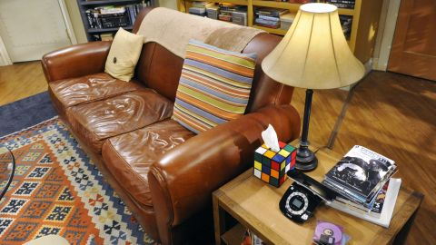 """Here we have one of the most important parts of the set and one true fans will immediately recognize, """"Sheldon's spot"""" on the couch. And that Rubik's cube tissue box? It was invented by executive producer Steve Molaro's friend Nicole Gastonguay."""