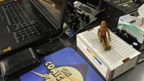"""An original Chewbacca action figure from the first """"Star Wars"""" collection is among the many representations of """"Star Wars"""" on the apartment set. Johnny Galecki, who plays Leonard Hofstadter on the show, fondly recalls collecting """"Star Wars"""" figures as a child so he loves things like this."""