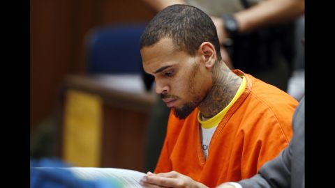 """<strong>March 2014:</strong> <a href=""""http://www.cnn.com/2014/03/17/showbiz/chris-brown-jail/index.html"""">Brown was jailed on March 14</a> after being booted from the Malibu, California, facility where he had been treated for four months. He was """"cooperative when taken into custody,"""" a sheriff's department statement said. A judge ordered him to stay in jail at a hearing three days later, revealing he was kicked out after counselors said he wrote a """"provocative"""" statement and violated other rehab rules."""