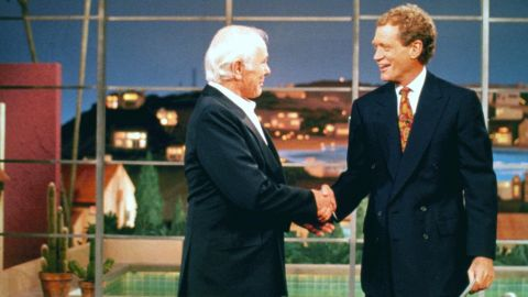 """Any moment with legend Johnny Carson and legend-in-the-making Letterman was destined to be a classic, but Carson's appearance on the """"Late Show"""" in May 1994 is the most memorable. The former """"Tonight Show"""" host opted to make his last TV showing with Letterman, who appropriately handed over his desk chair to his idol."""