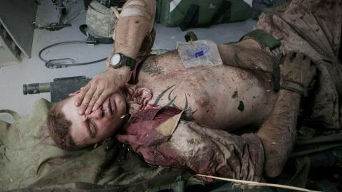 Cpl. Burness Britt, an injured U.S. Marine, reacts after being lifted onto a helicopter in June 2011.