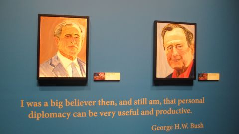 A self-portrait of former President George W. Bush, left, and a portrait Bush painted of his father, former President George H.W. Bush, is on display Friday, April 4, at the George W. Bush Presidential Library and Museum in Dallas.