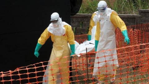Staff of the 'Doctors without Borders' ('Medecin sans frontieres') medical aid organisation carry the body of a person killed by viral haemorrhagic fever, at a center for victims of the Ebola virus in Guekedou, on April 1, 2014. The viral haemorrhagic fever epidemic raging in Guinea is caused by several viruses which have similar symptoms -- the deadliest and most feared of which is Ebola. AFP PHOTO / SEYLLOU        (Photo credit should read SEYLLOU/AFP/Getty Images)