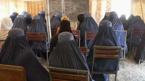 """Afghan female university students, dressed in the traditional blue burqa, attend a math class under a tent at the Nangarhar University campus in Jalalabad in September  2012. Under Taliban rule, between 1994 and 2001 <a href=""""http://www.cnn.com/2012/03/08/opinion/afghanistan-women-rights-barr/"""">women were banned from education and work</a>, even from leaving their homes unaccompanied."""