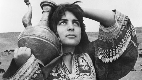 A nomad girl shows off her elaborate costume which is unique to women from the Afghan Pashtun ethnic group to which nomads also belong. The date when this photograph was taken is unknown.