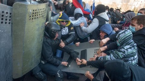 Pro-Russian protesters clash with police as they try to occupy a regional administration building in Donetsk on April 6.