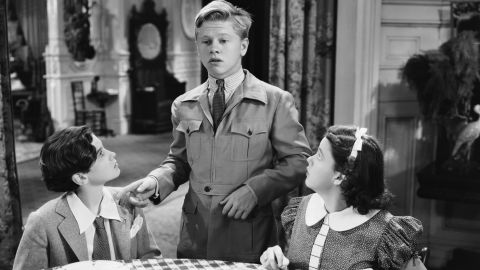 """Mickey Rooney stars with Judy Garland and Ronald Sinclair in a scene from the comedy """"Thoroughbreds Don't Cry."""""""