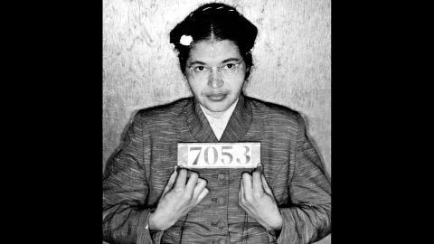 Rosa Parks poses for her booking photo after she was arrested in Montgomery, Alabama, for refusing to give up her bus seat to a white passenger in 1955.