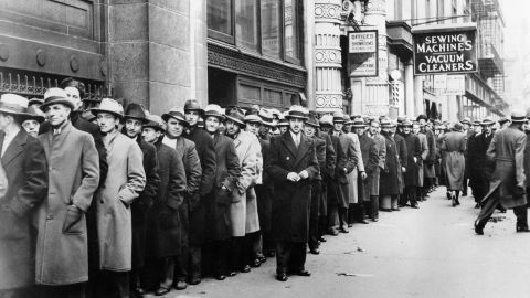 Thousands of unemployed people waited in line to register for federal relief jobs in New York in 1933. The unemployment rate rose to 25% that year.