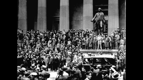 """People gathered across from the New York Stock Exchange on """"Black Thursday,"""" October 24, 1929. The stock market crash of 1929, fueled by excessive speculation on Wall Street, set off the Great Depression."""
