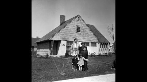 Truck supervisor Bernard Levey with his family in front of their new home in 1950. The post-war period was a prosperous time for middle-class Americans.