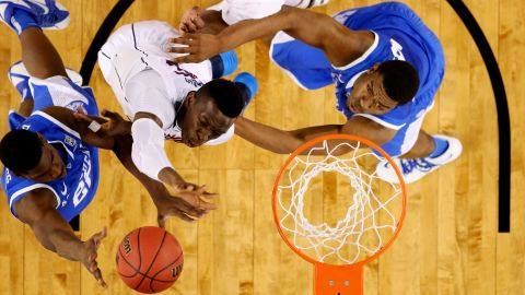 Kentucky Wildcat Alex Poythress goes up for a basket against Amida Brimah of the Connecticut Huskies during the NCAA Men's Championship on April 7, 2014.