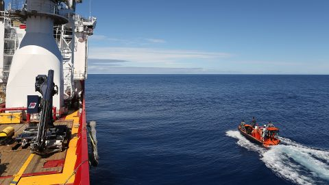 A fast response craft manned by members of ADV Ocean Shield's crew and Navy personnel pass by the starboard side of the ship as the boat searches the ocean for debris of the missing Malaysia Airlines MH 370. Mid-Caption The Australian Maritime Safety Authority (AMSA) continues to direct the search for Malaysia Airlines Flight MH370 from the Rescue Coordination Centre in Canberra in conjunction with the Australian Transport Safety Bureau (ATSB). Retired Air Chief Marshal Angus Houston AC AFC is leading a Joint Agency Coordination Centre (the JACC) that is based in Perth to coordinate the Australian Government's support for the search for MH370. Joint Task Force Headquarters -- JTF 658, at Fleet Base West is coordinating supporting military forces engaged in the air and sea search., JTF 658 is commanded by Commodore Peter Leavy