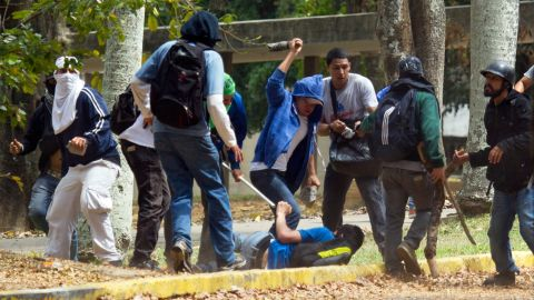 An opposition student struggles with members of a pro-government group at the Central University of Venezuela on April 3.