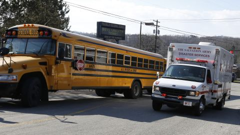 A Salvation Army disaster services vehicle drives past a school bus onto the campus of the Franklin Regional School District where several people were stabbed at Franklin Regional High School, Wednesday, April 9, 2014 in Murrysville, Pa., near Pittsburgh. The suspect, a male student, was taken into custody and being questioned. (AP Photo/Keith Srakocic)