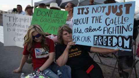 Krissy Thornton, right, and Burgundy Hall protest the cattle roundup on Wednesday, April 9.