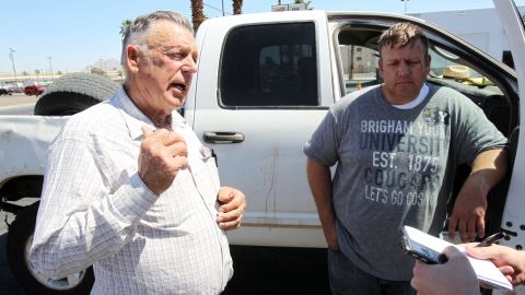 Cliven Bundy, left, and his son Dave talk to a reporter in Las Vegas on Monday, April 7. Bundy's dispute with the government began two decades ago, when the Bureau of Land Management changed grazing rules for the 600,000-acre Gold Butte area to protect an endangered desert tortoise, KLAS reported. Bundy refused to abide by the changes and stopped paying his grazing fees to the federal bureau, which he contends is infringing on state rights.