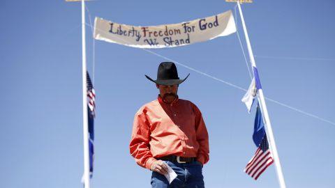 Rancher Derrel Spencer speaks during a rally in support of Bundy on April 7.