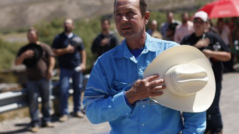 Chris Miller holds his hand over his heart during a rally in support of Bundy on April 7.