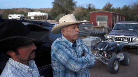 Cliven Bundy, right, and Clance Cox stand at the Bundy ranch on April 5.