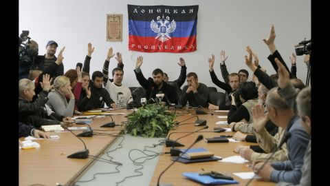"""Members of the self-proclaimed government the """"Donetsk Republic"""" vote April 10 during a meeting at the seized regional administration building in Donetsk."""