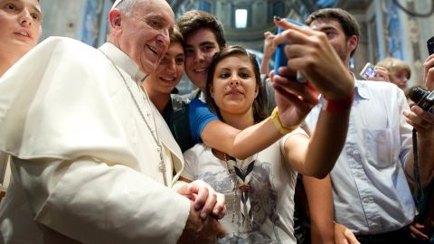 Francis has his picture taken inside St. Peter's Basilica with youths who came to Rome for a pilgrimage in August 2013.