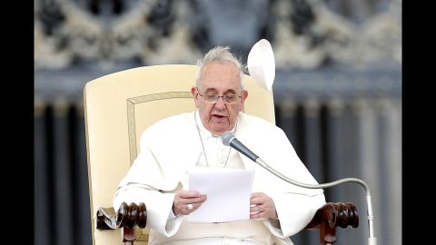 Wind blows the papal skullcap off Pope Francis' head in February 2014.