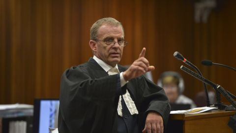 State prosecutor Gerrie Nel attends a hearing of South African Paralympic athlete Oscar Pistorius' trial at the North Gauteng High Court in Pretoria on March 12, 2014. Oscar Pistorius's murder trial saw a dramatic re-enactment of how the toilet door he shot his girlfriend though was damaged by gunshots and a cricket bat. AFP PHOTO / POOL / ALEXANDER JOEALEXANDER JOE/AFP/Getty Images
