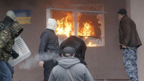 The Horlivka police station burns on April 14.