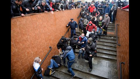 Pro-Russian supporters beat a pro-Ukrainian activist during a rally in Kharkiv on Sunday, April 13.