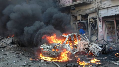 Flames engulf a vehicle following a car bomb in the Karm al-Loz neighborhood of Homs on Wednesday, April 9.